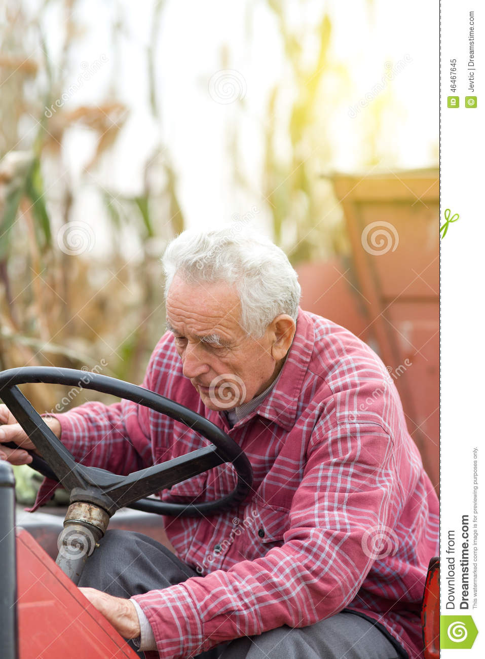 Guy Fixing Tractor : Old man with tractor stock photo cartoondealer