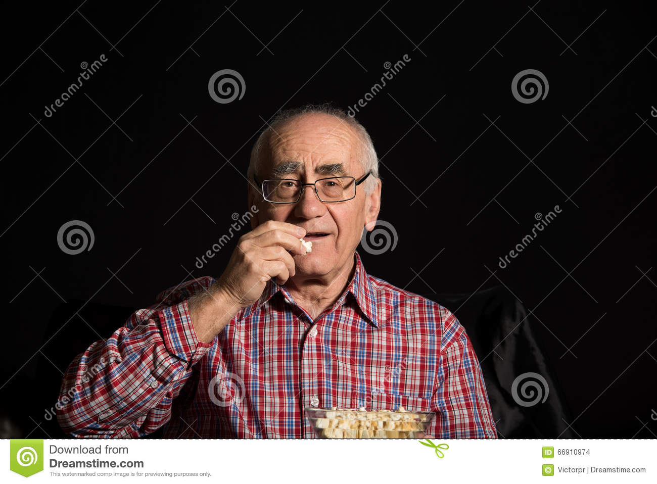 Senior man watches tv
