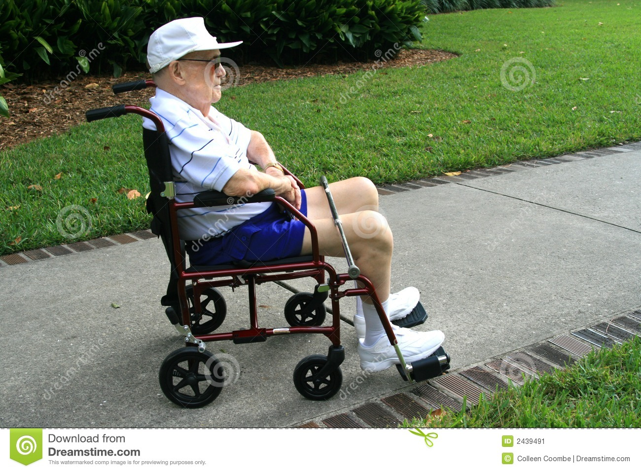 Man In Wheel Chair - Royalty free stock photo