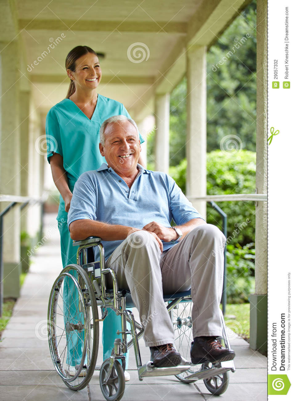 Senior men in wheelchair with nurse in the park of a hospital