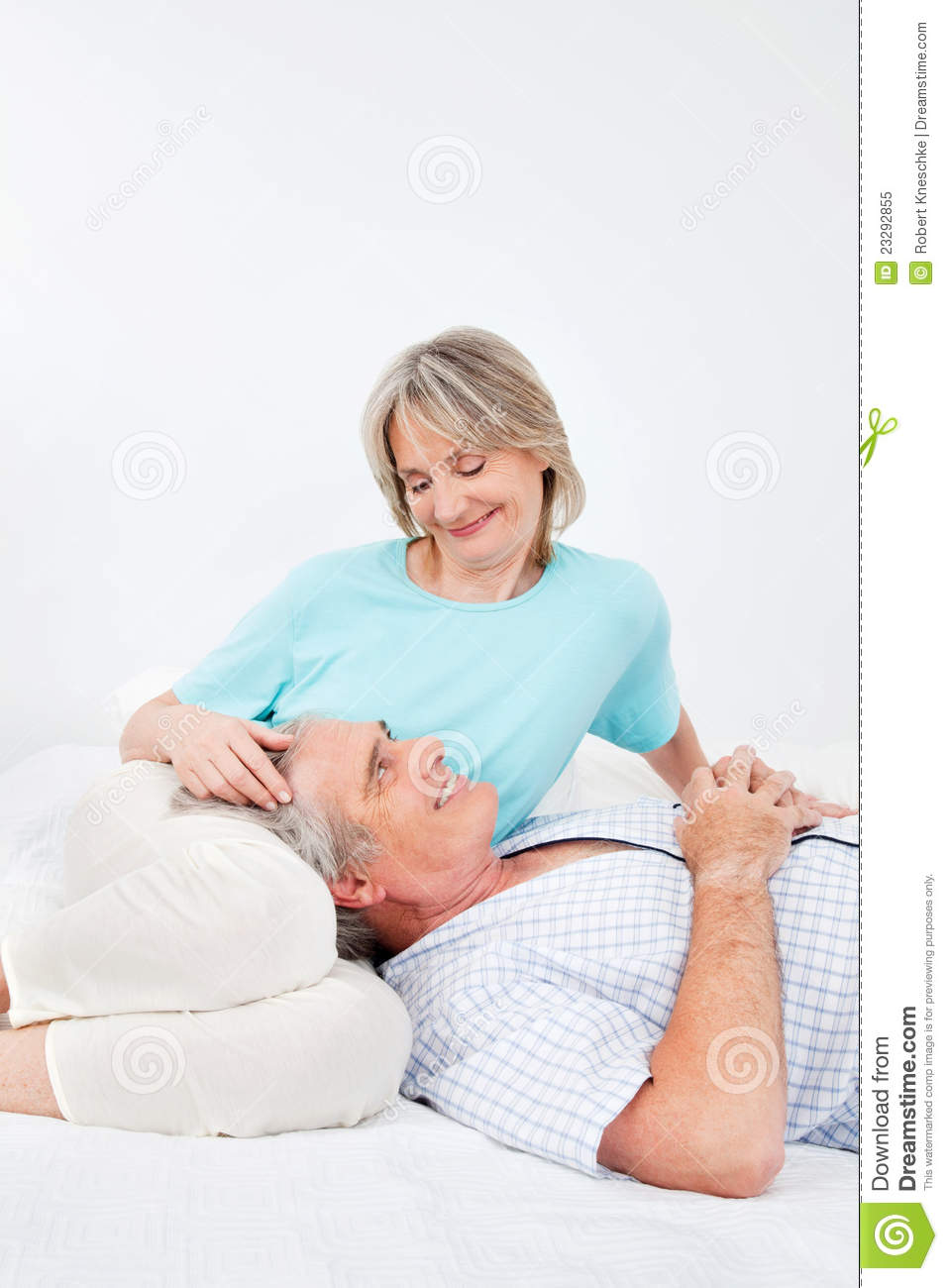 Senior Man And Woman In Bedroom Royalty Free Stock Photo ...