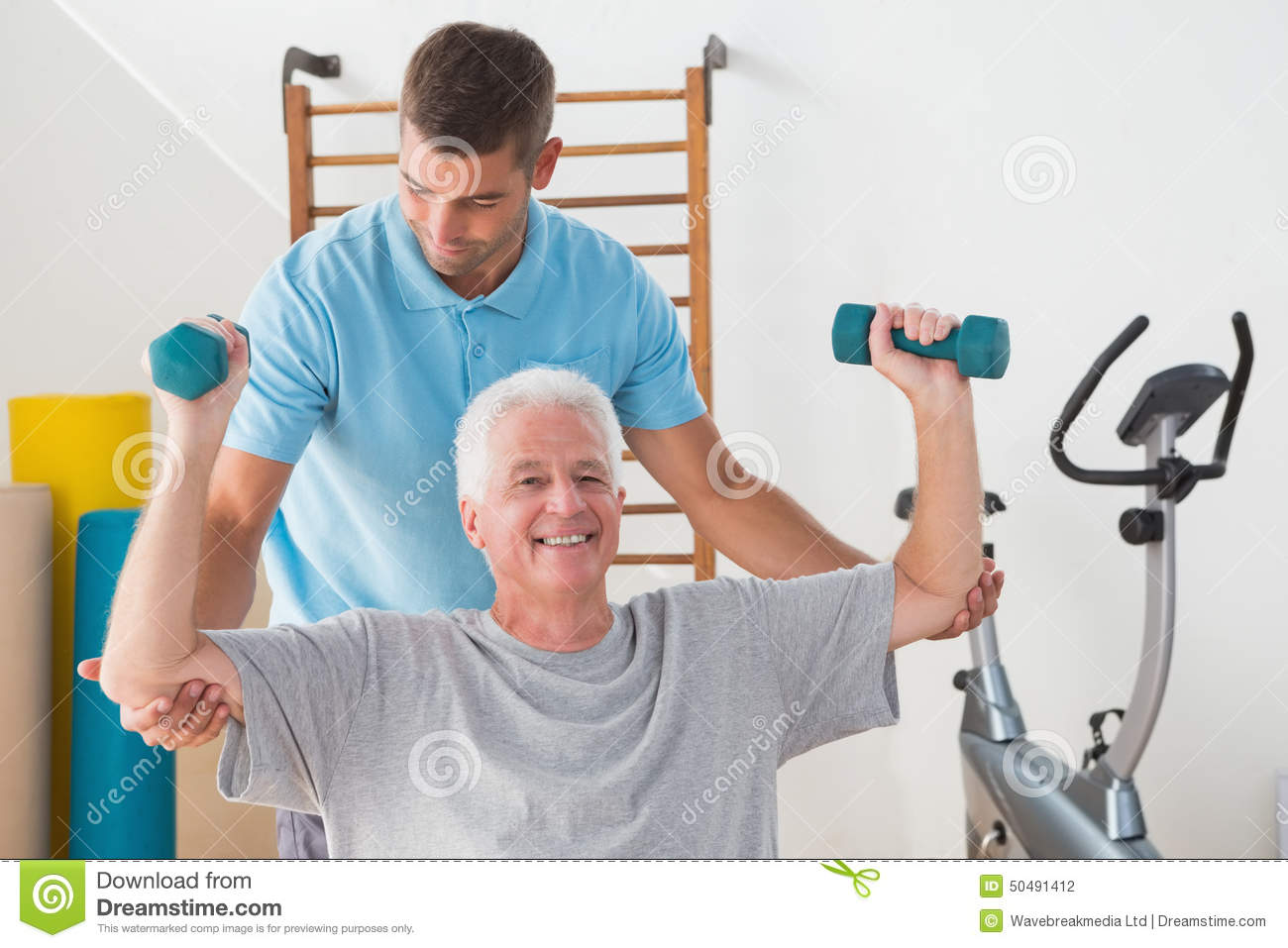 Senior Man Working Out With His Trainer Stock Photo ...