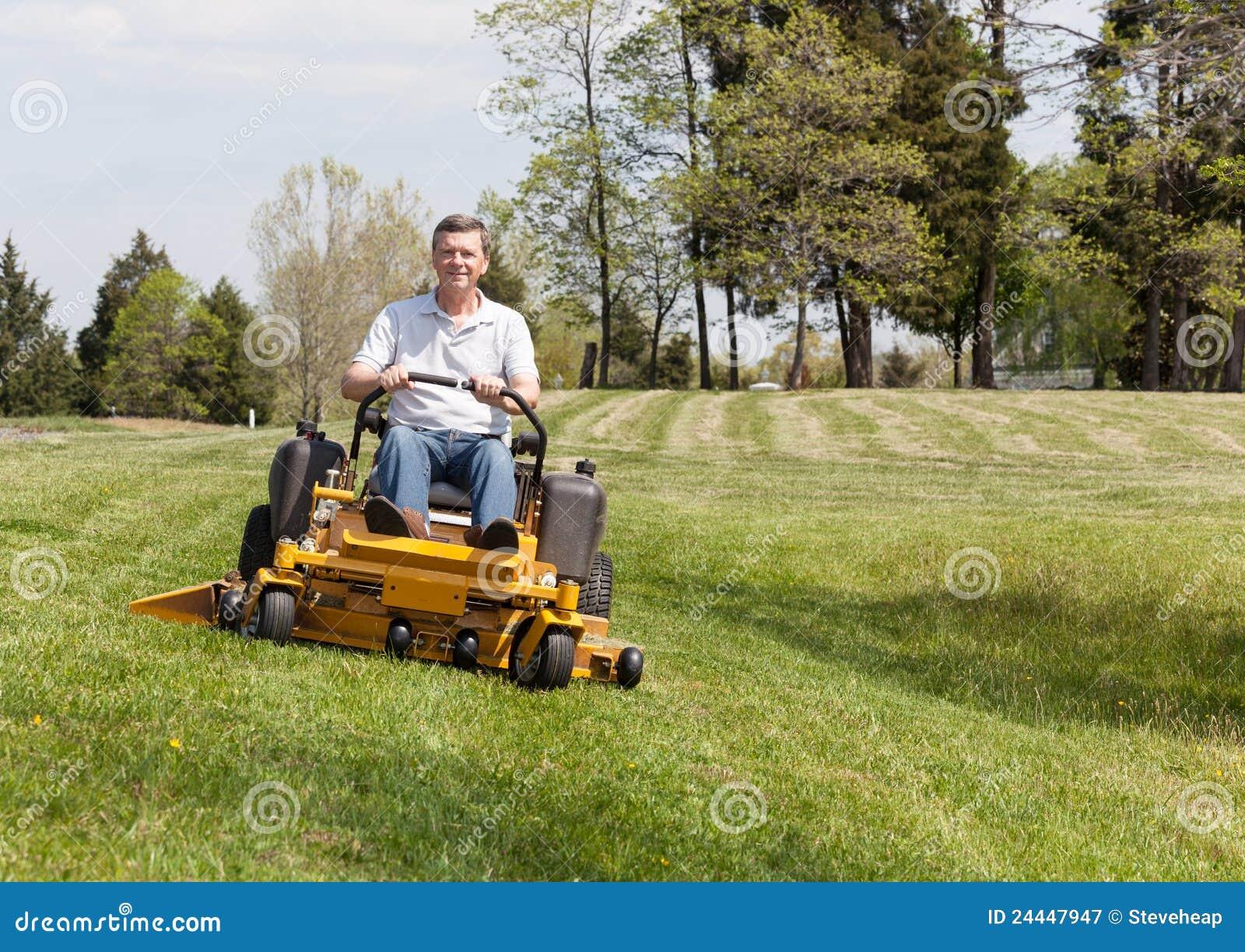 senior man on zero turn lawn mower on turf royalty free