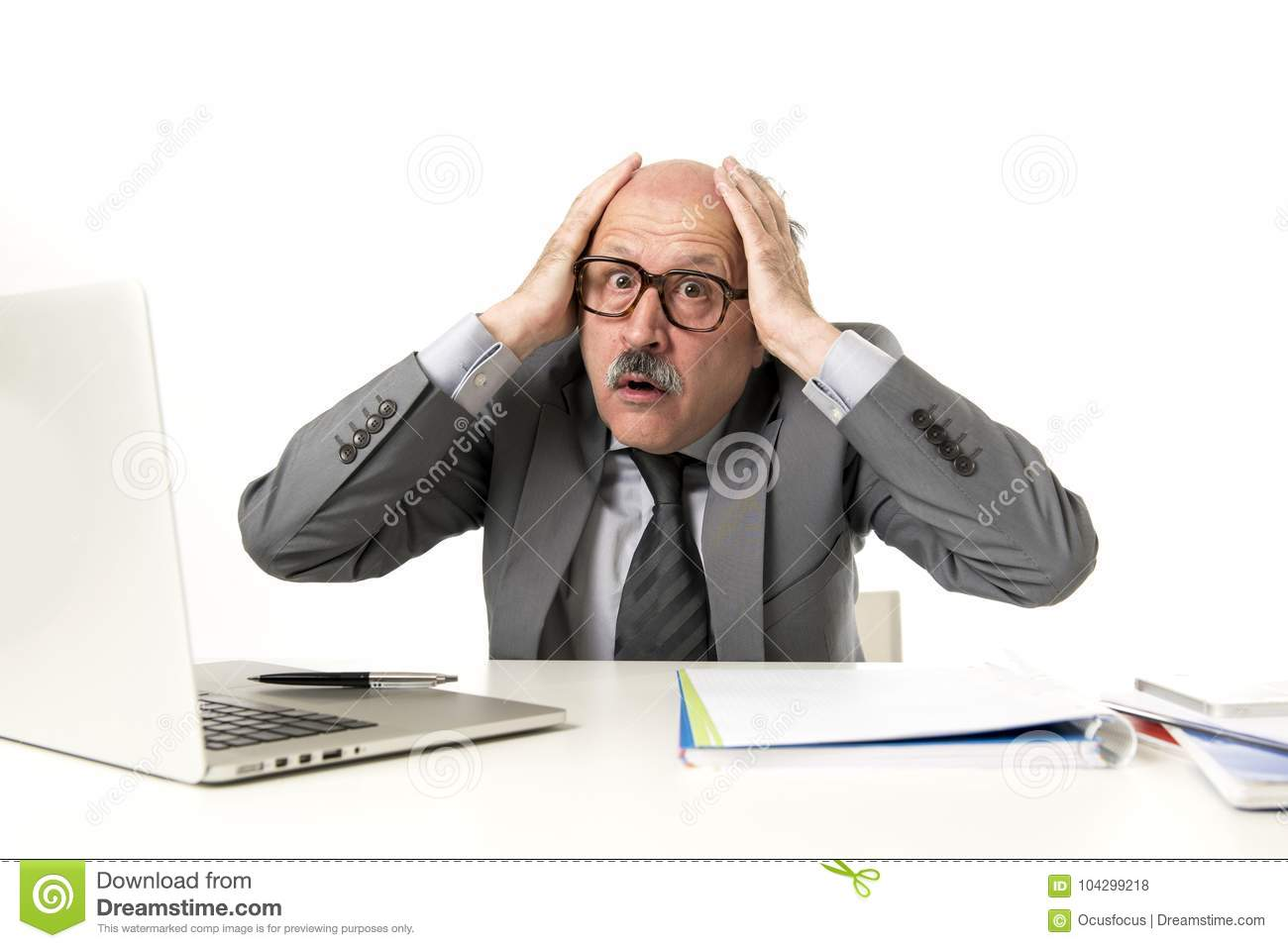 Senior mature busy business man with bald head on his 60s working stressed and frustrated at office computer laptop desk looking a