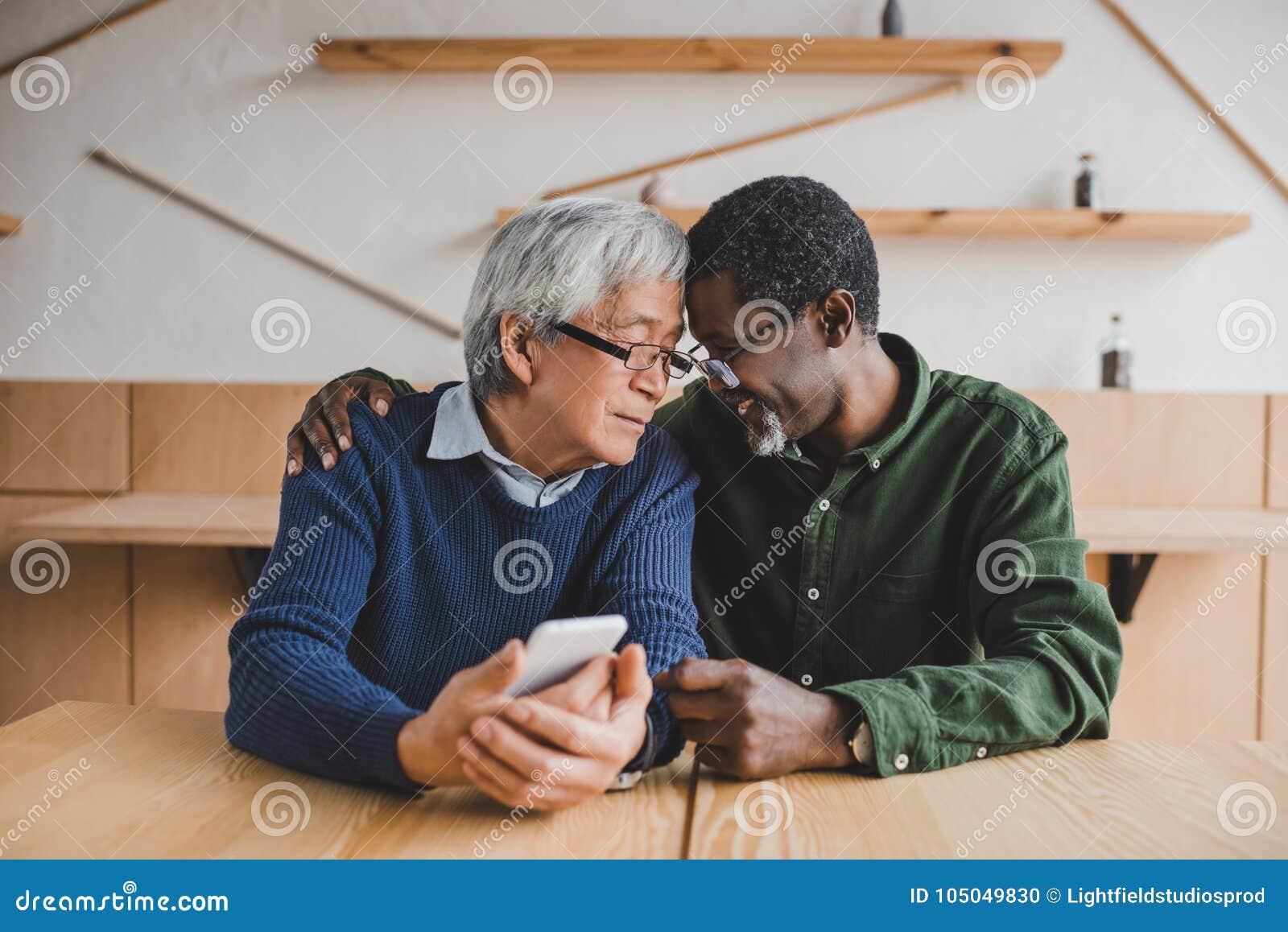 Senior men embracing