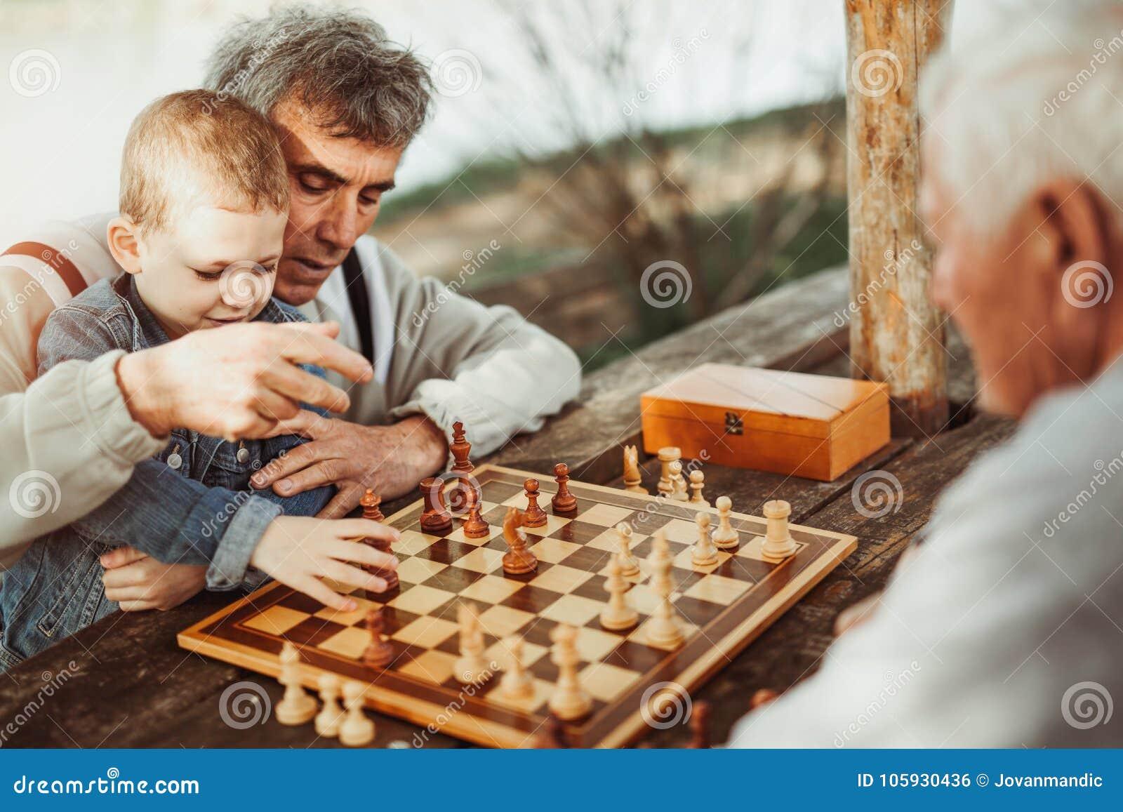 Senior men having fun and playing chess