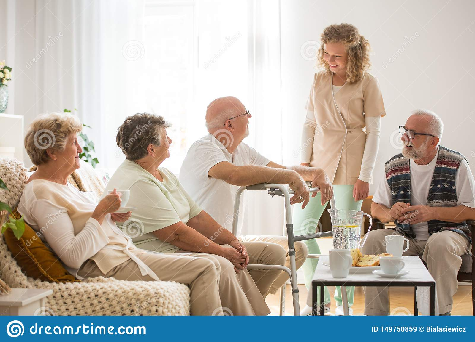 Senior Patients With Helpful Young Nurse At Nursing Home Stock Image Image Of Osteoporosis Grandfather 149750859