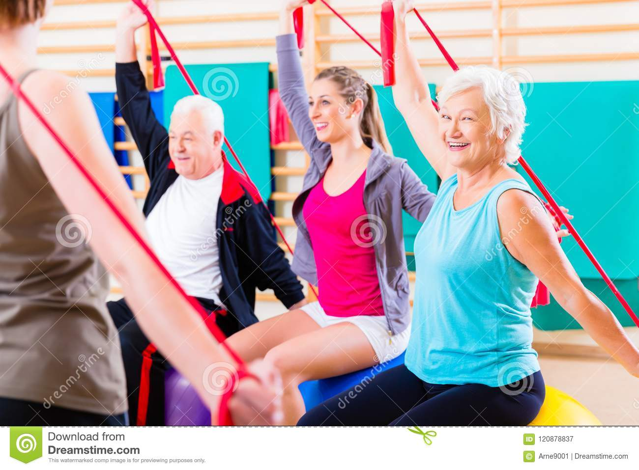 Senior People At Fitness Course In Gym Stock Image - Image of group