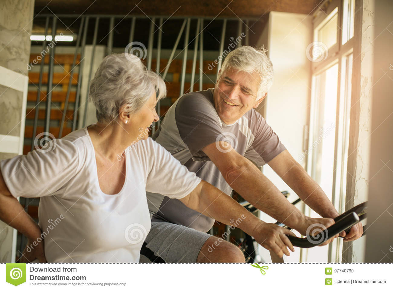Senior People Workout In The Gym  Senior Man Sitting On The Stock