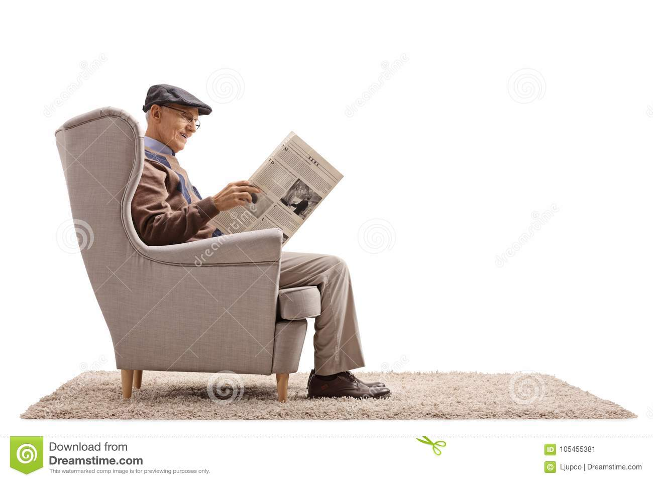 Senior Seated In An Armchair Reading A Newspaper Stock ...