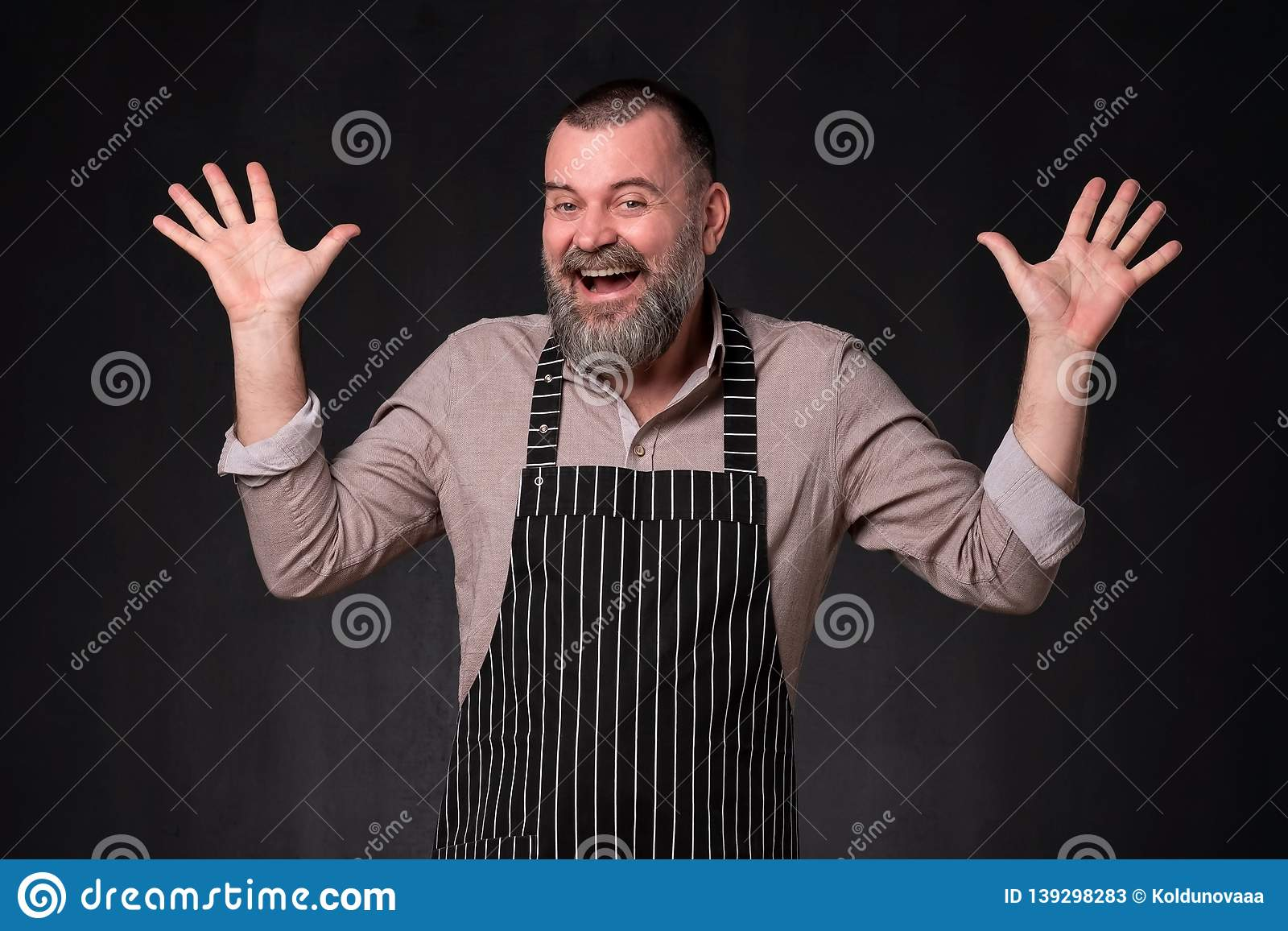 Senior shocked shopman man, looking at camera with wide opened mouth shouting.