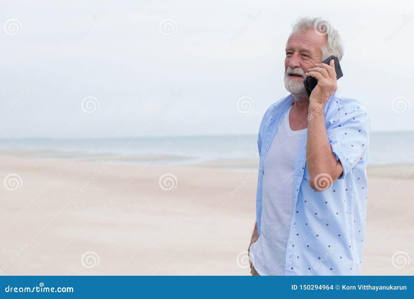 Senior Single Man Talking On Calling During Vacation At