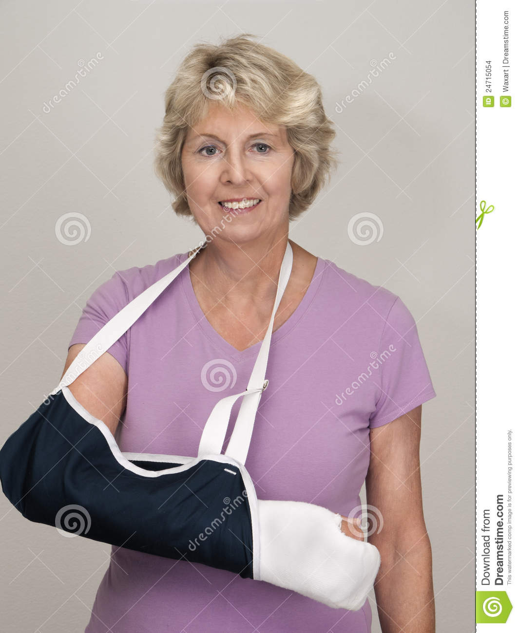 Senior Woman With Arm In Cast And Sling Stock Photo