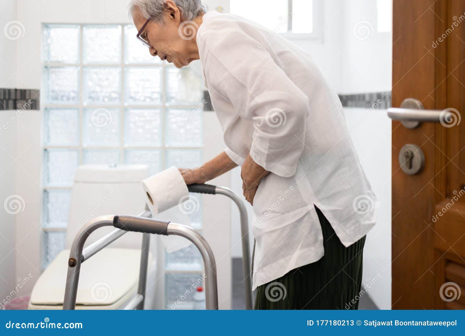 Senior Woman With Diarrhea Holding Tissue Roll Near A ...