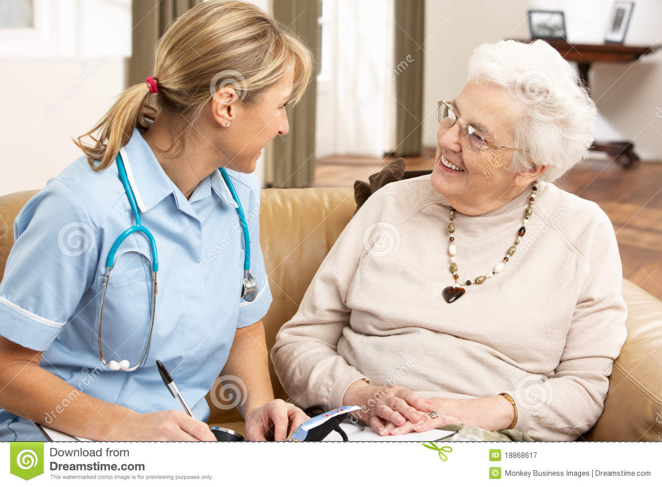 Senior Woman In Discussion With Health Visitor