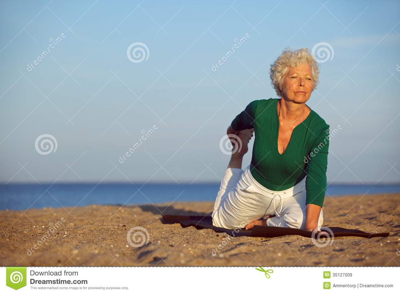 old woman nudist in beach