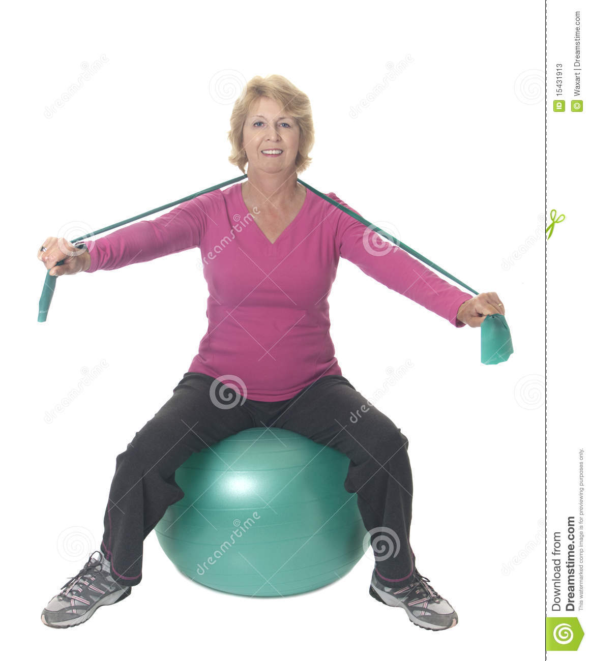 ... On Exercise Ball With Resistance Band Stock Photos - Image: 15431913