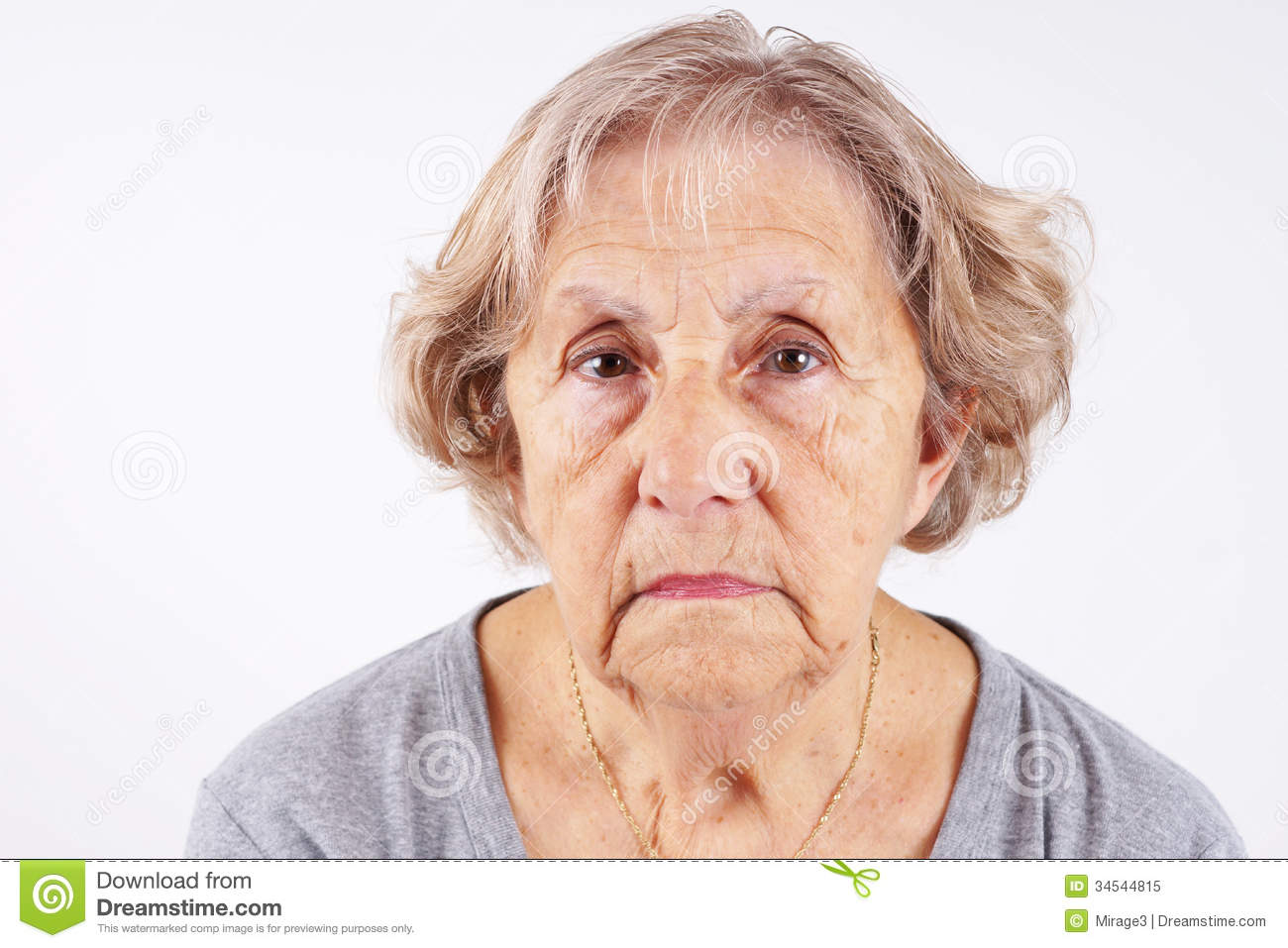Face of senior woman, candid, natural, no retouching, great details.