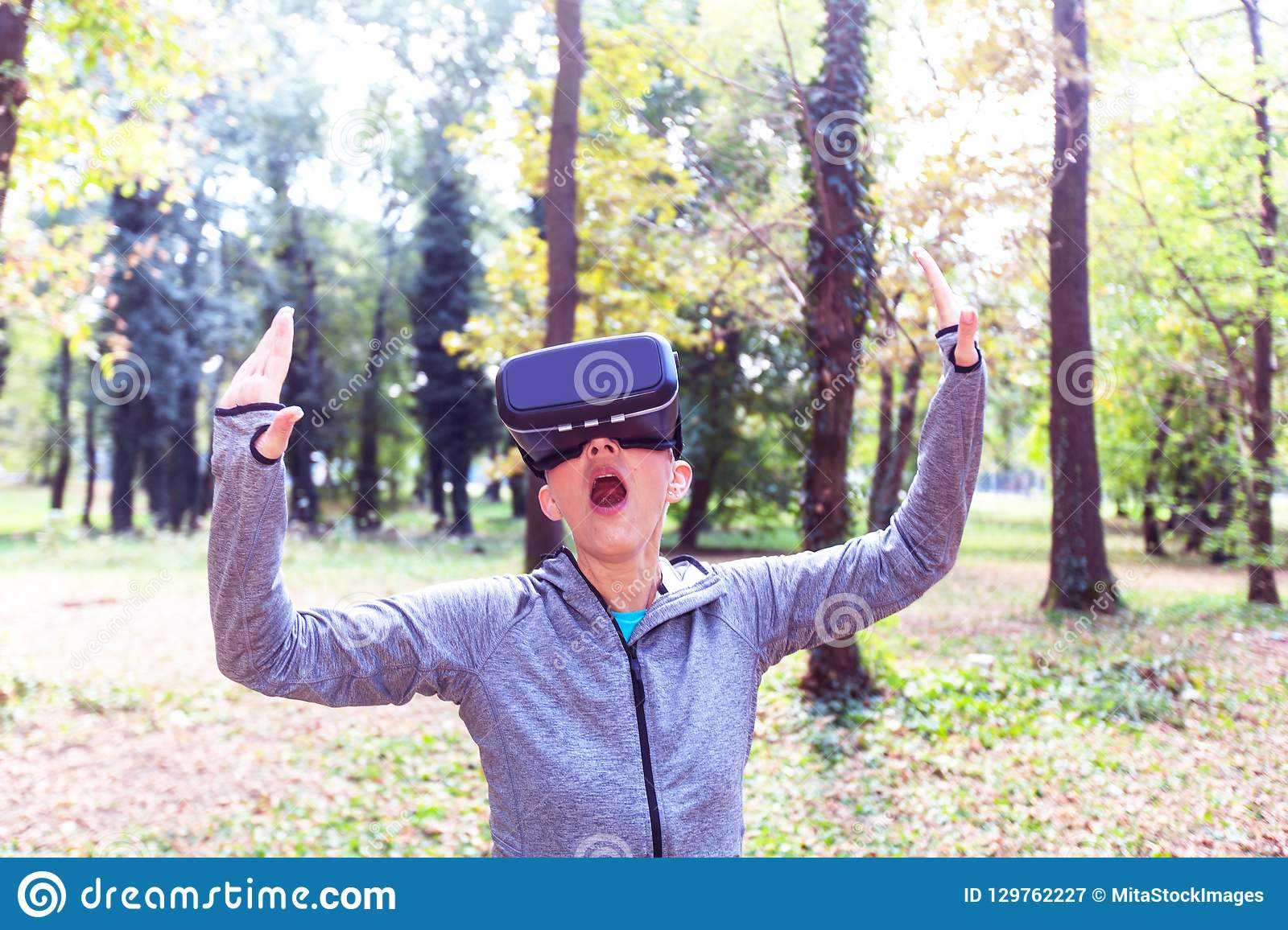3d822a57c7 Senior Woman Fun With Virtual Reality Headset In Forest Stock Image ...