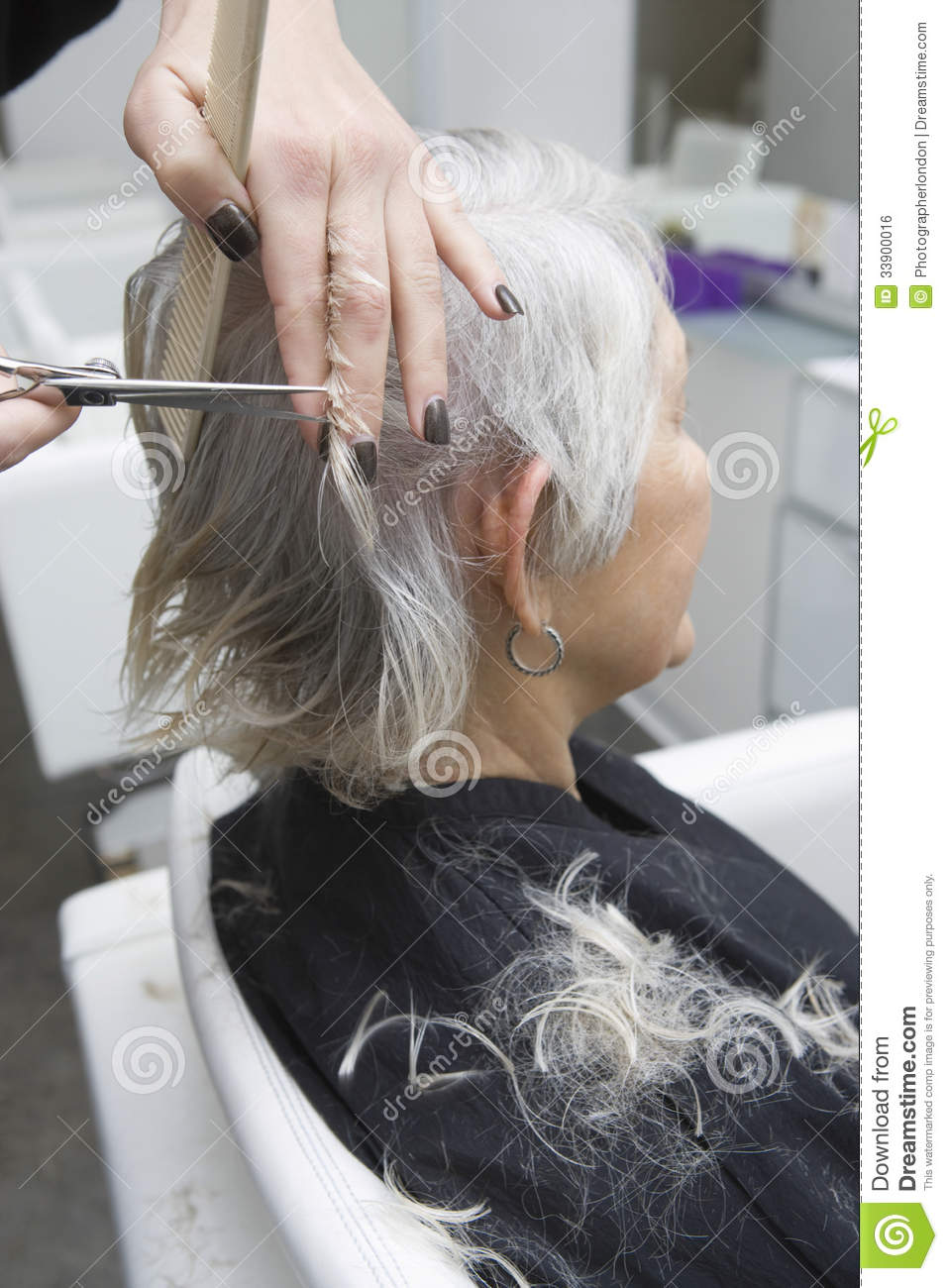 Senior Woman Getting Haircut In Salon Royalty Free Stock