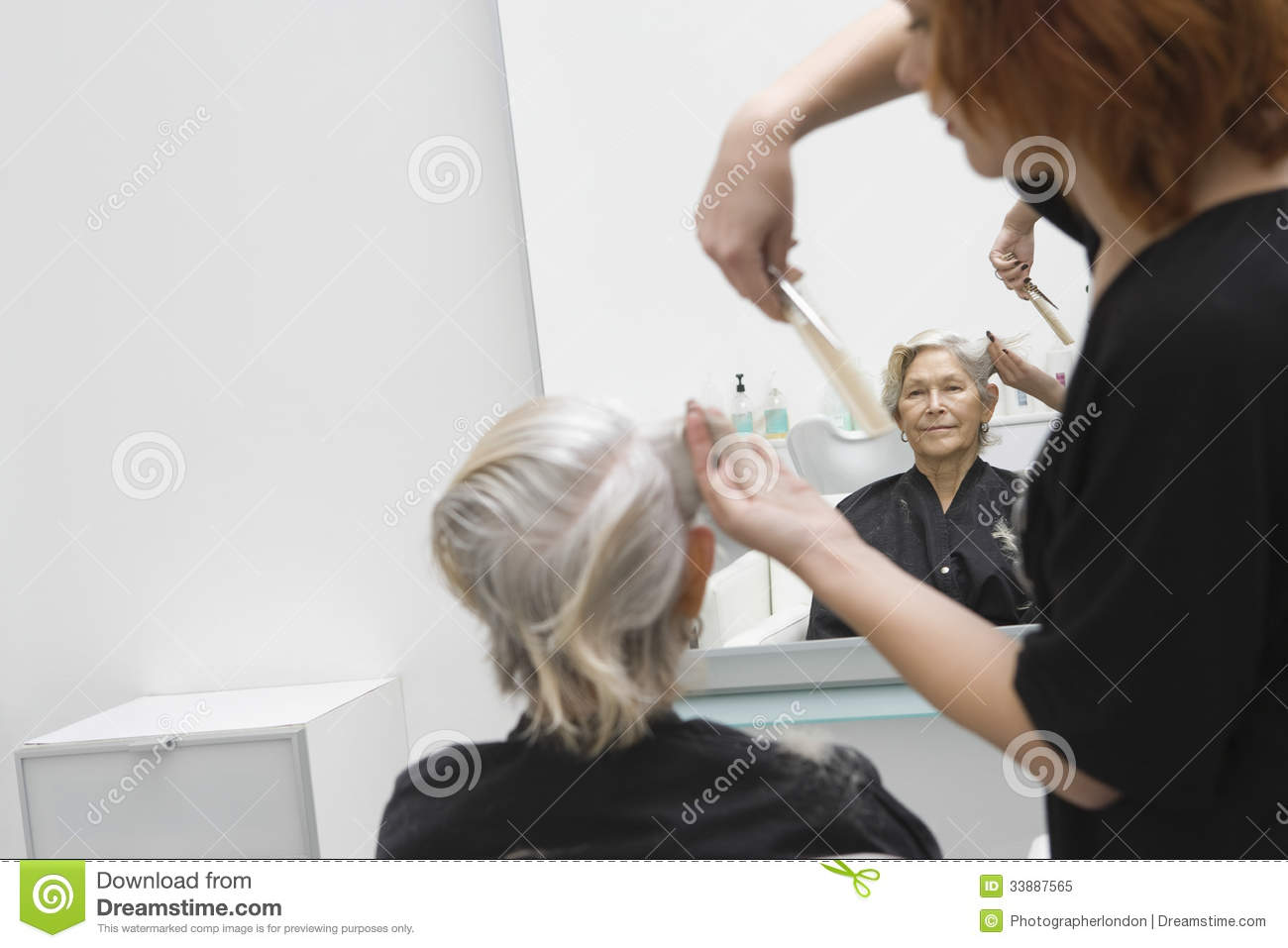 Senior woman getting haircut in salon royalty free stock for Salon seniors