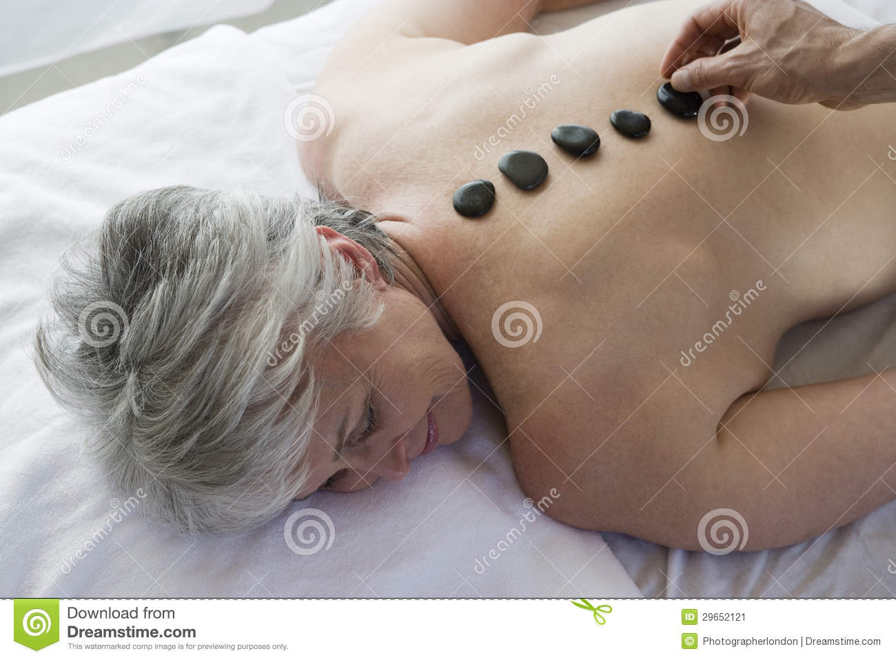Senior Woman Getting Hot Stone Therapy