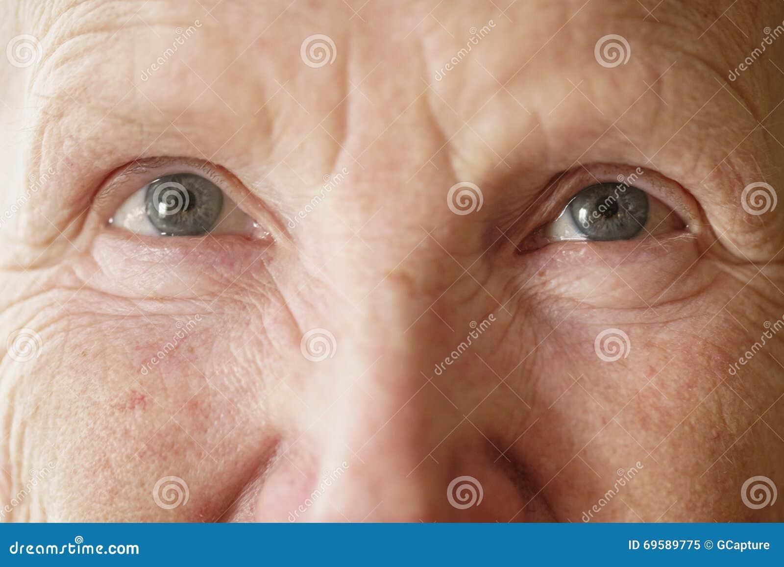 Senior woman grandma eyes looking to camera close up portrait
