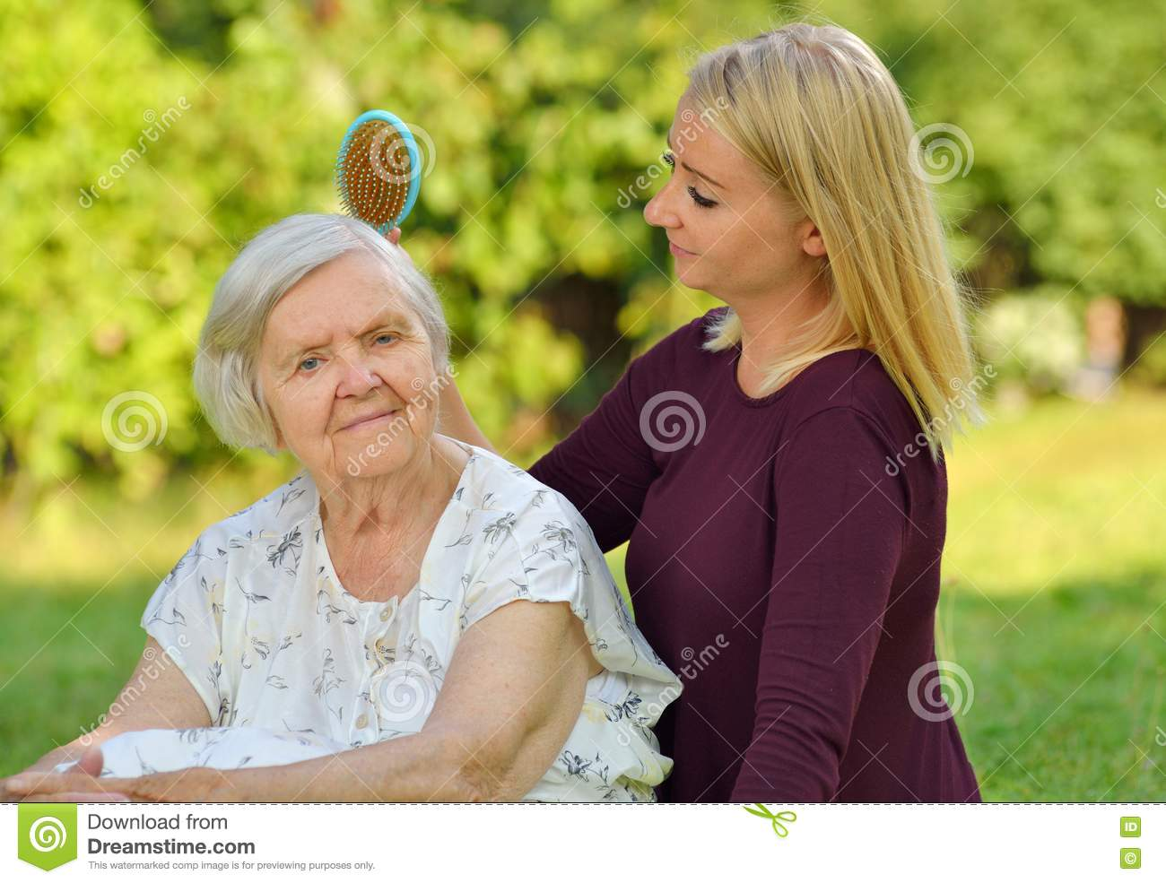 Senior woman with her caregiver.