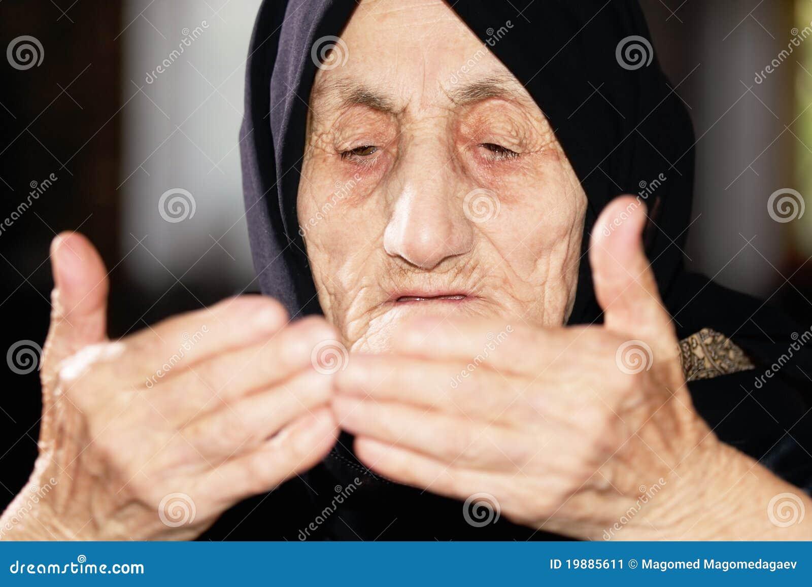 Senior woman looking at hands