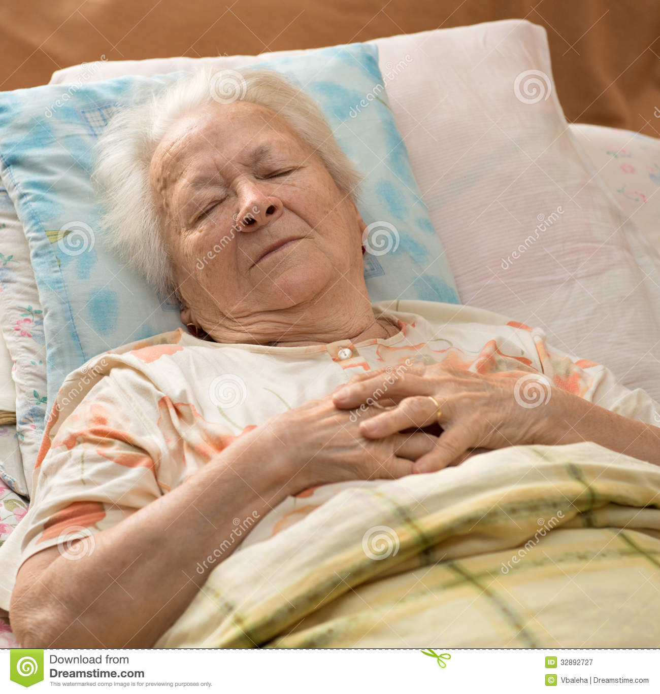 Senior Woman Lying At Bed Royalty Free Stock Photography