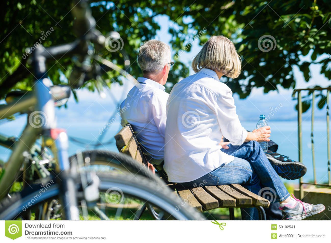 Senior woman and man at rest on bike trip