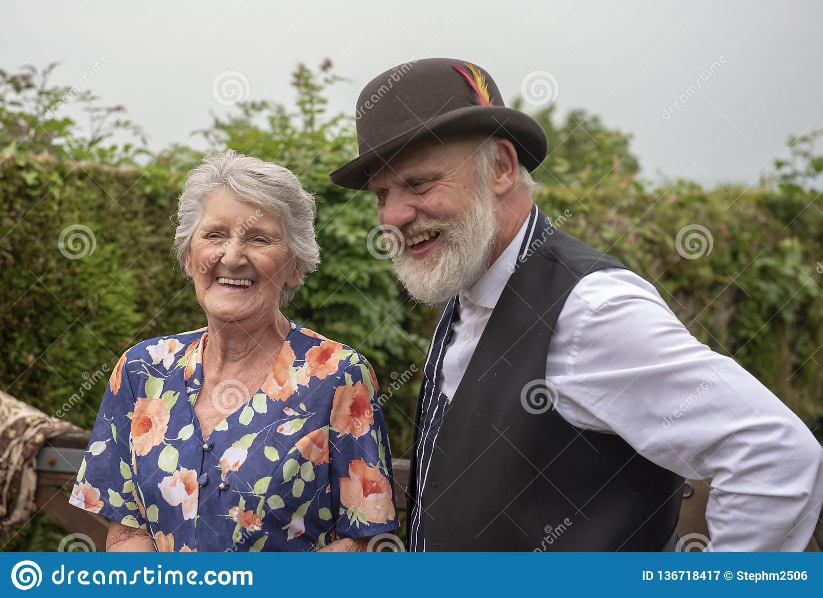 Senior woman and mature man outdoors