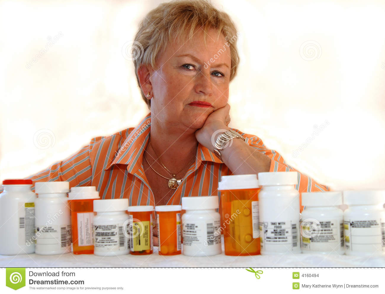 Senior woman with medicine bottles