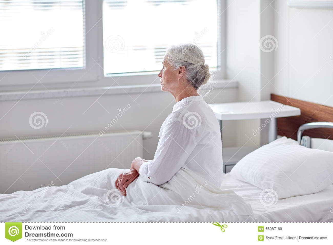 Senior Woman Patient Lying In Bed At Hospital Ward Stock