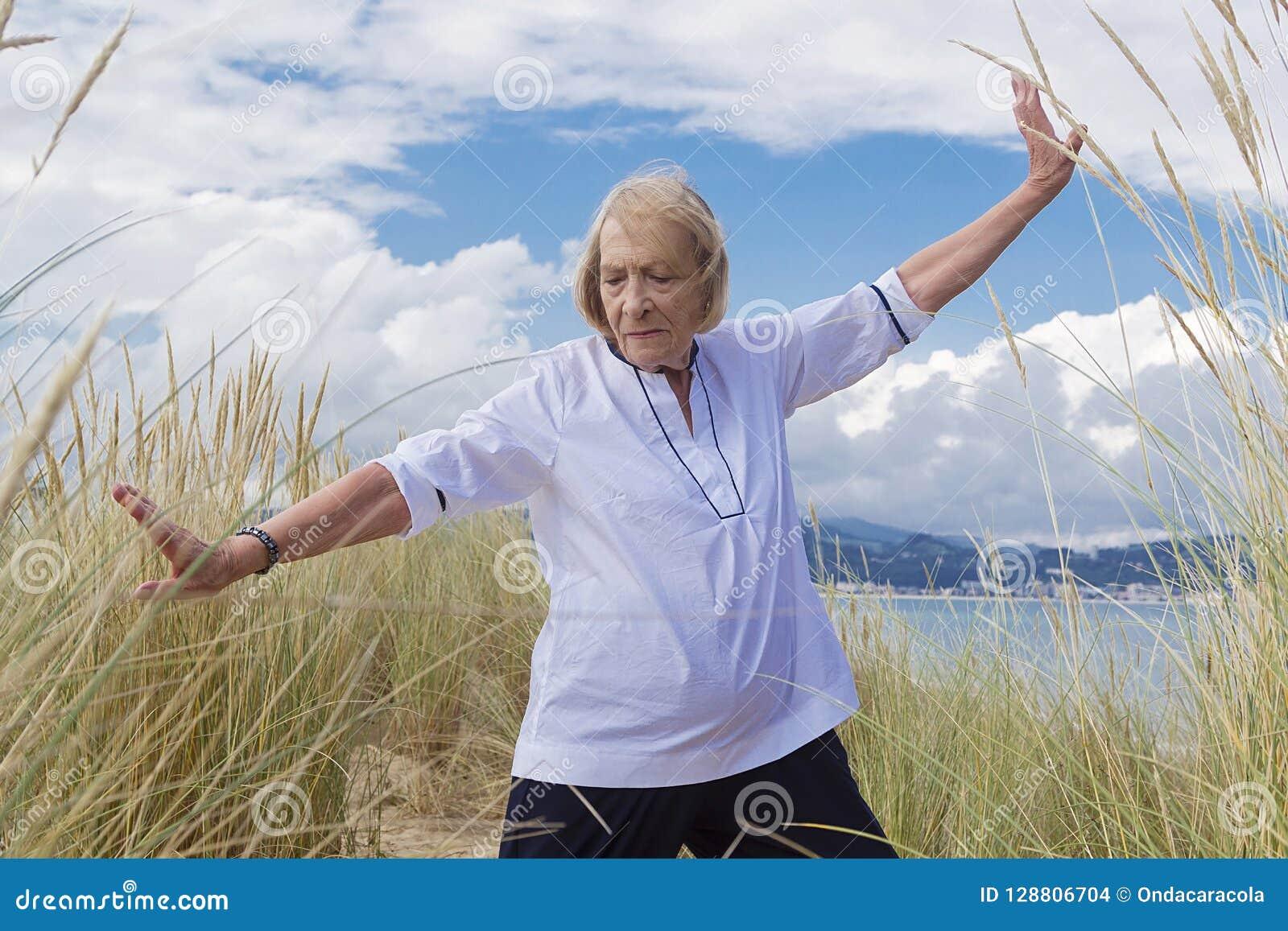 A Senior Woman Practicing Tai Chi Stock Photo - Image of