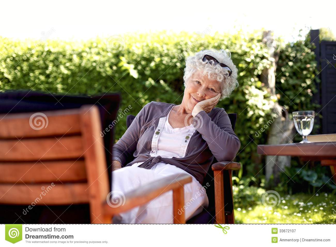 Senior woman relaxing in backyard garden