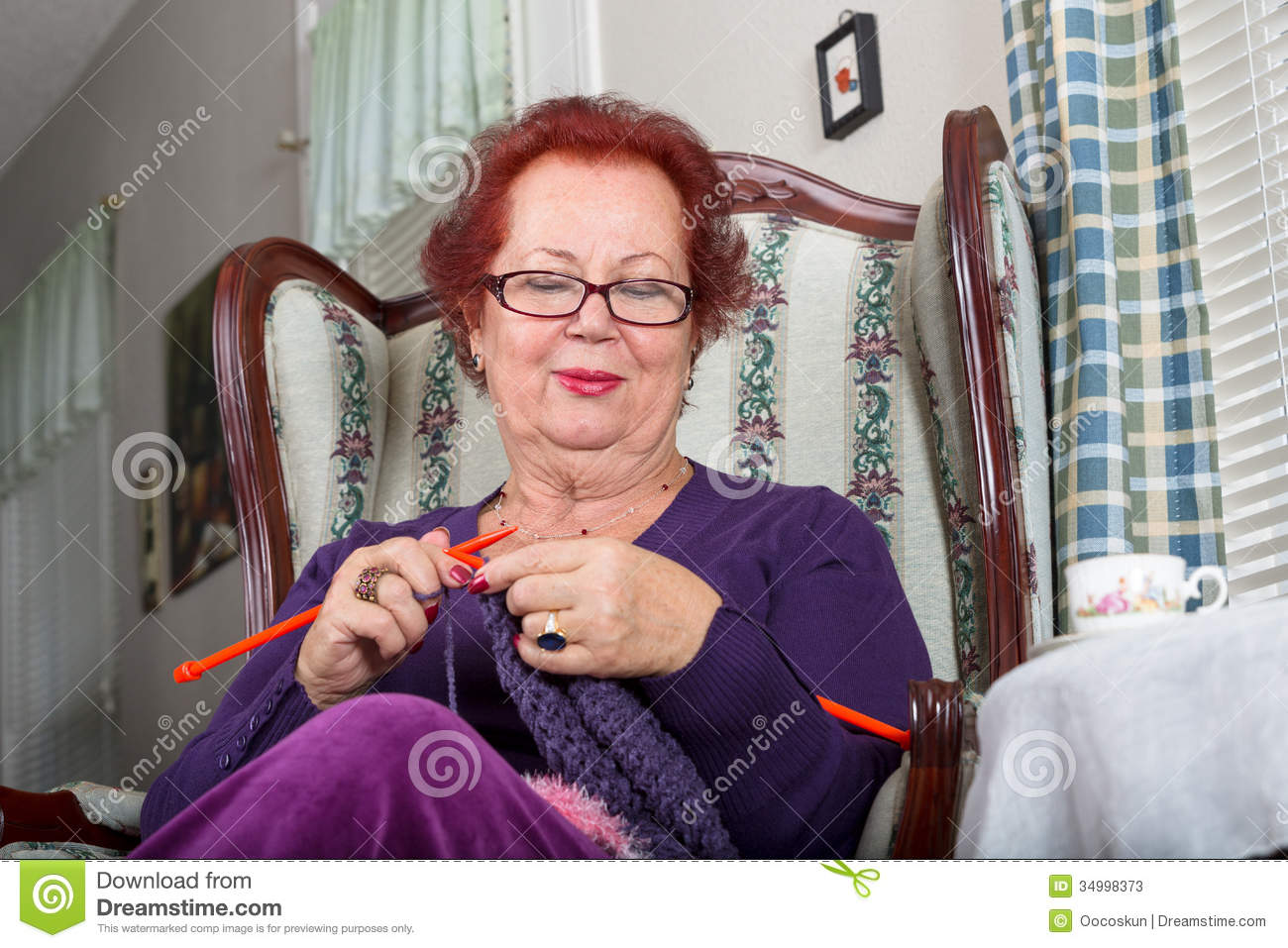 Old Lady Knitting Images : Senior woman relaxing while knitting happily stock photos