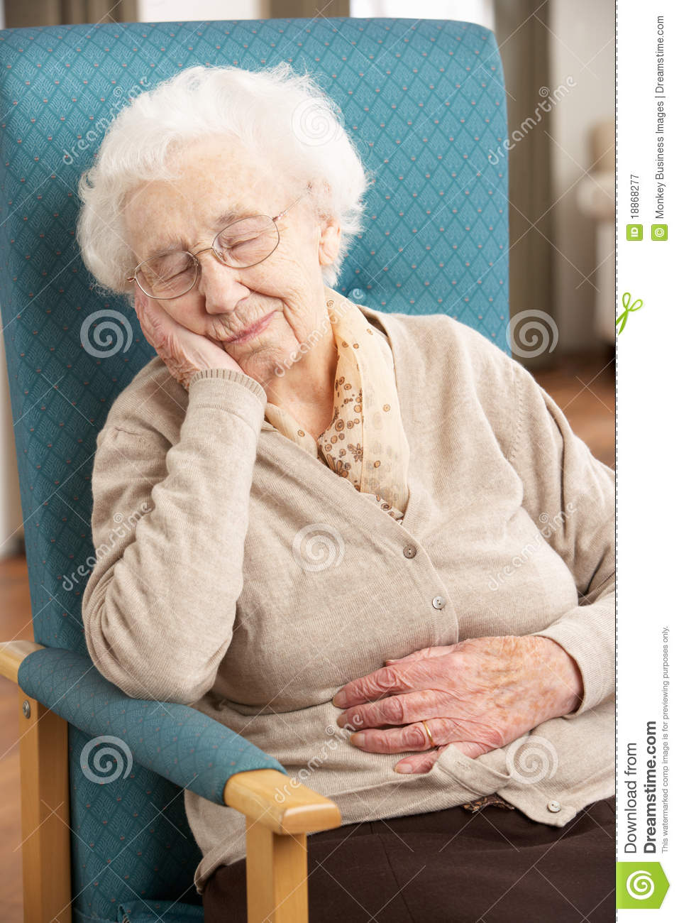 Senior Woman Resting In Chair Stock Image