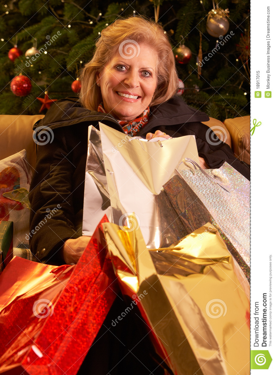 Senior Woman Returning After Christmas Shopping Tr Royalty