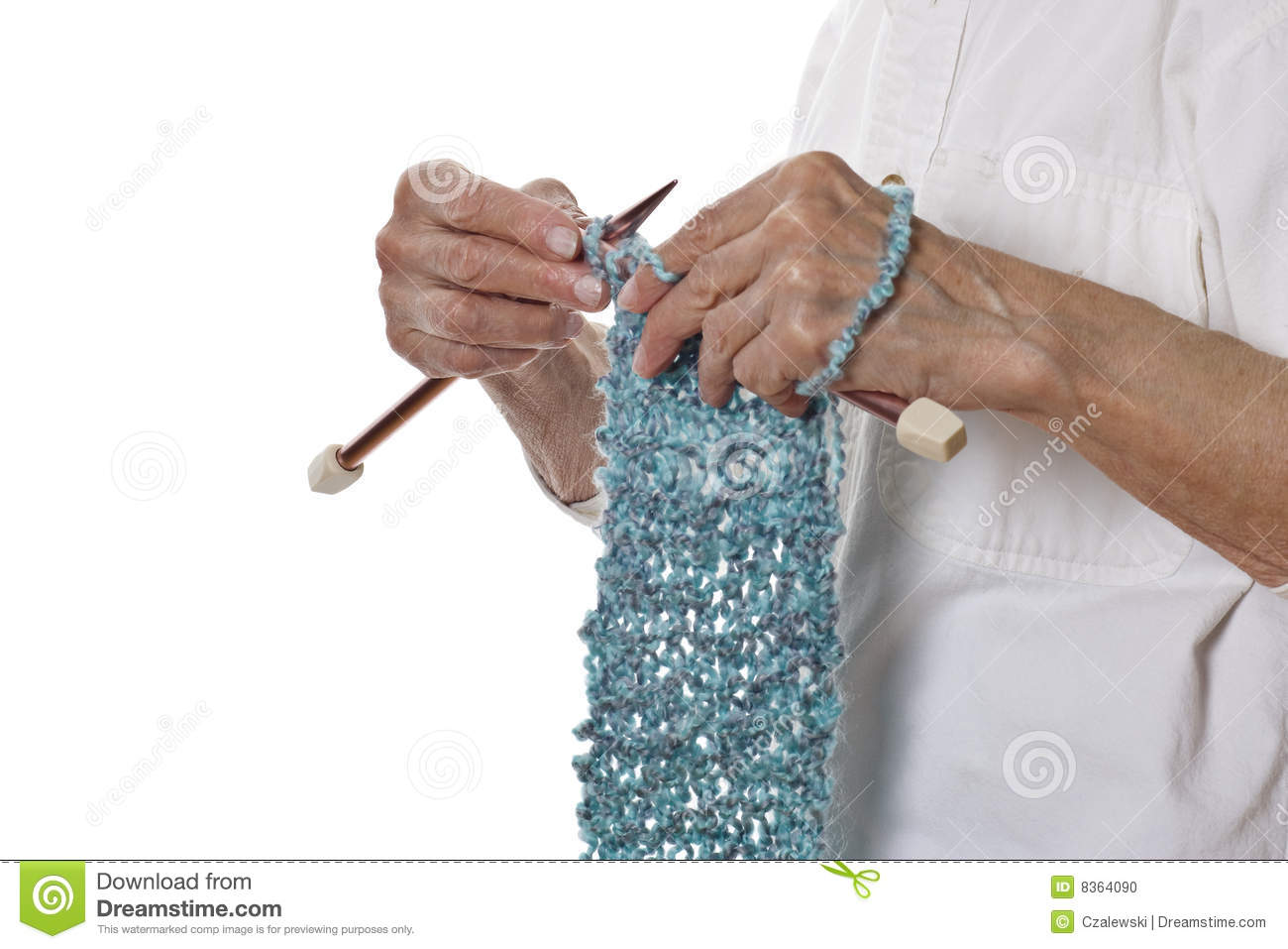 Knitting With Hands Only : Senior woman s hands knitting a blue scarf stock photo