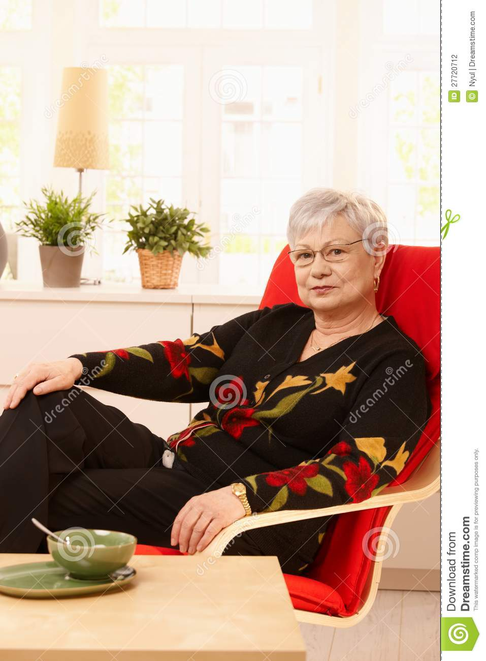 Senior woman sitting in armchair stock photography image for Sitting in armchair