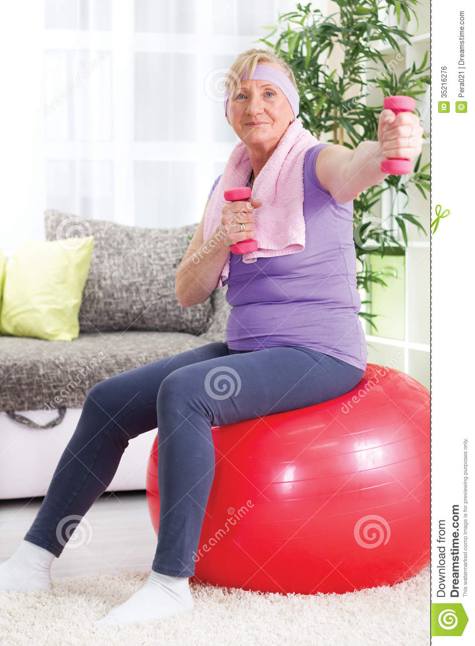 Senior Woman Sitting On Gym Ball, And Exercise With ...