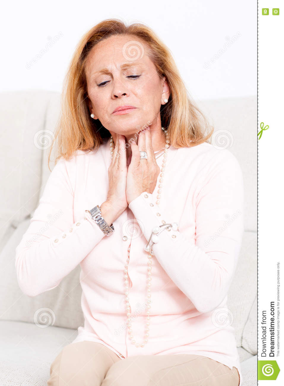 Senior woman with sore throat