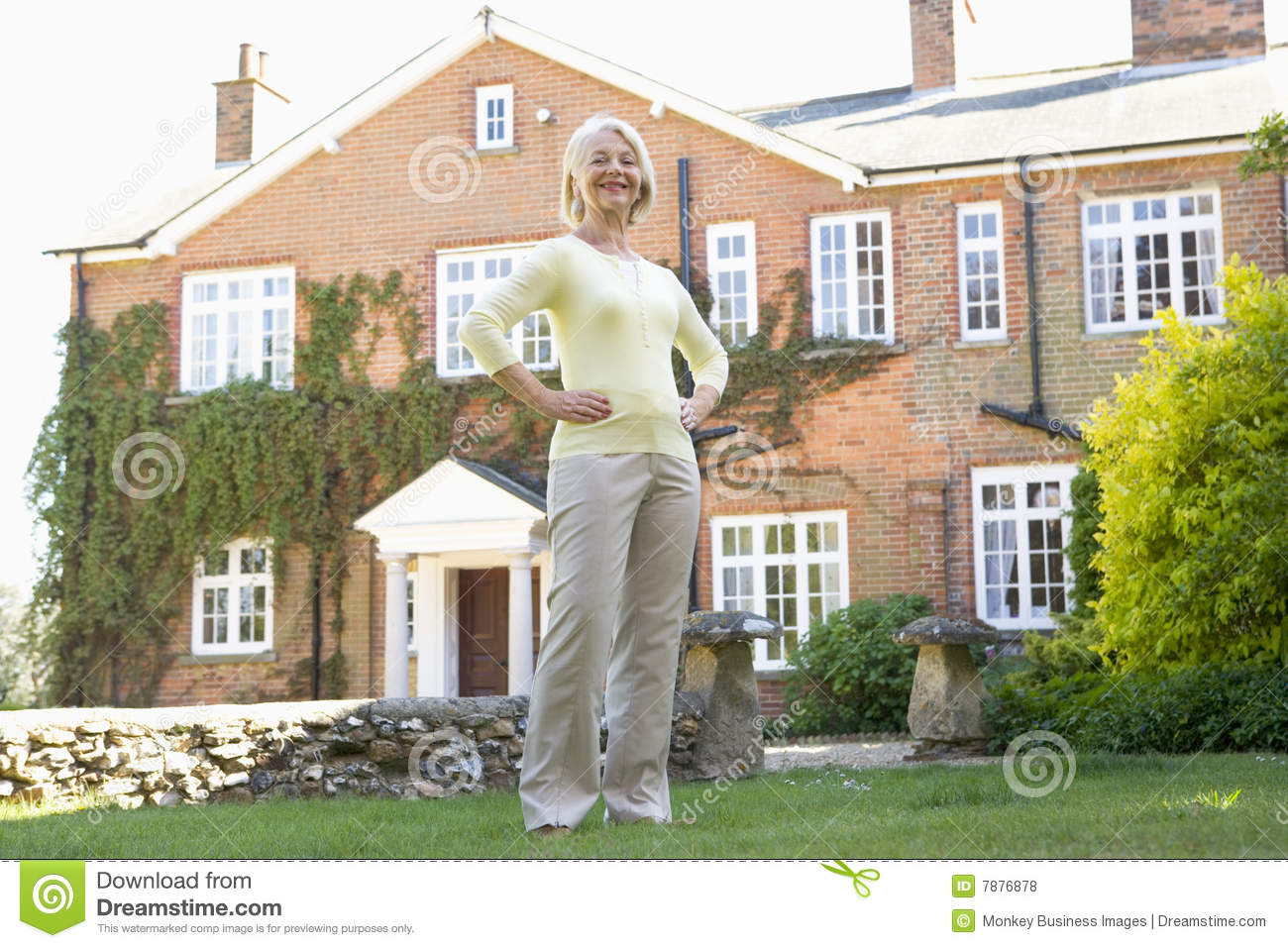 Senior Woman Standing Outside House Royalty Free Stock