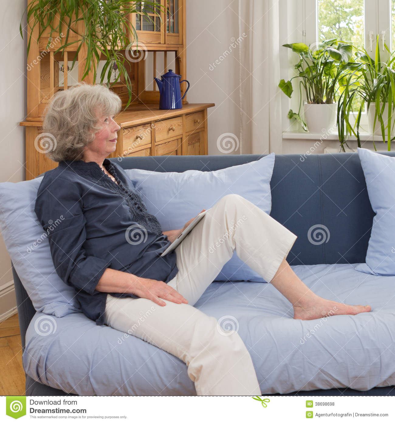 Senior woman with tablet on sofa stock photo image 38698698 for 15x15 living room