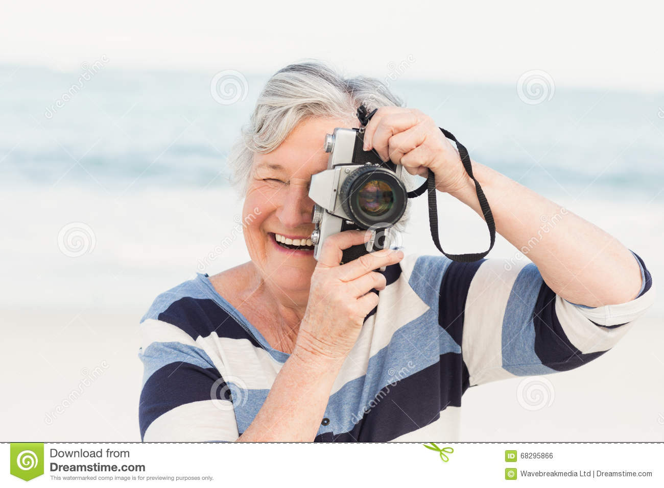 Senior woman taking picture