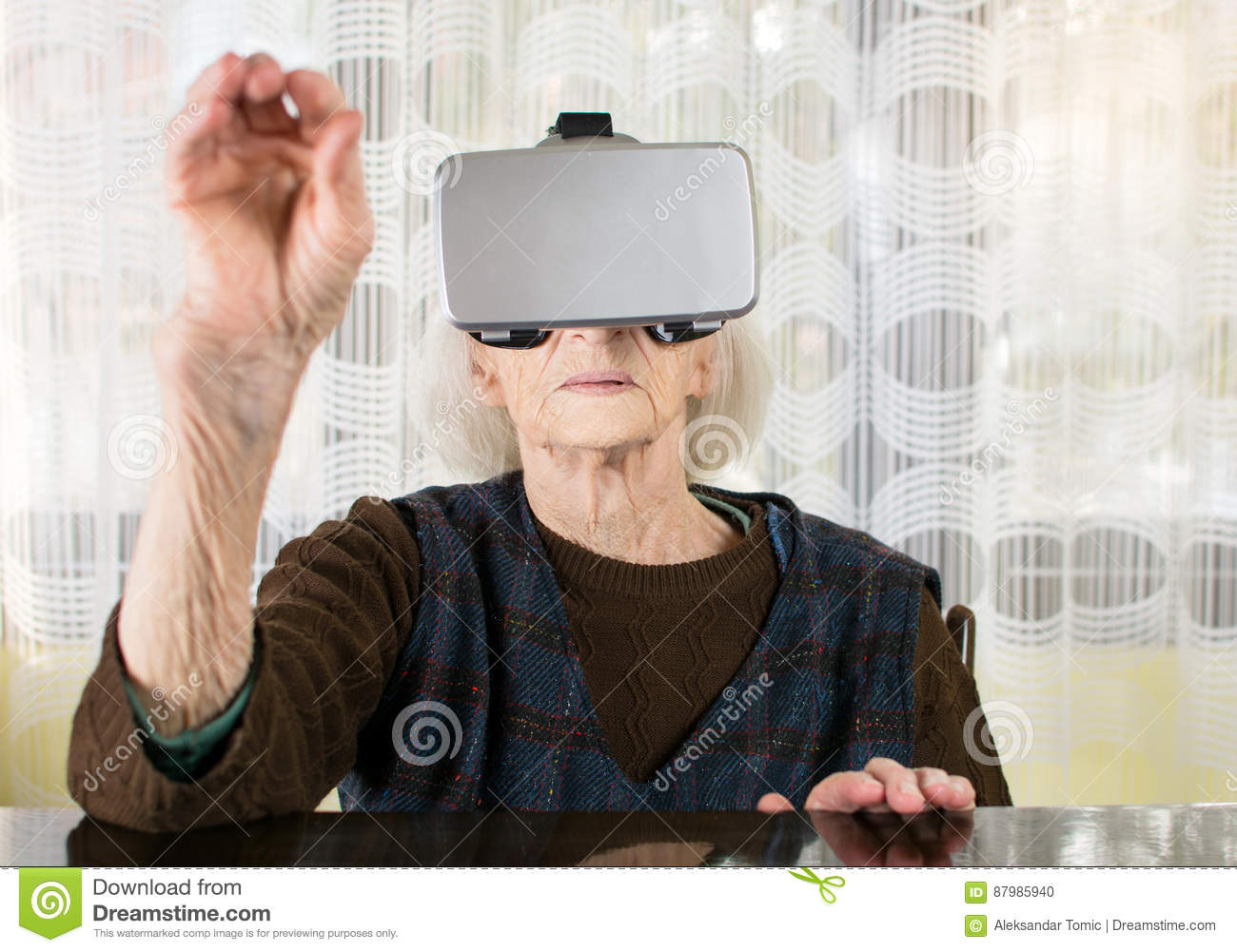 fba2c6f2ea Senior Woman Using Virtual Reality Goggles Stock Photo - Image of ...