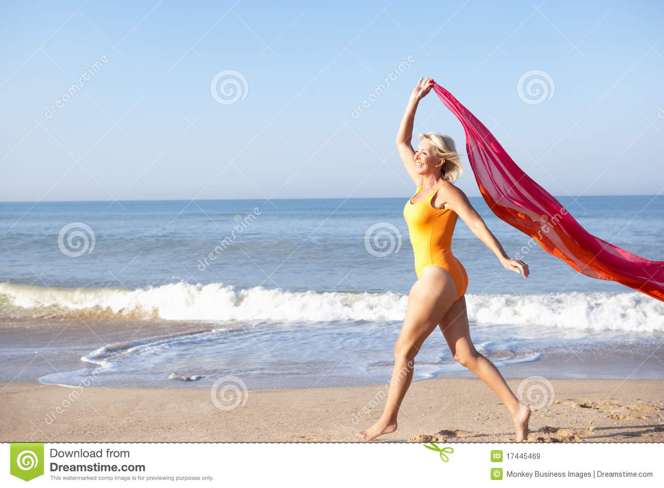 Woman walking on a beach royalty - Beach Senior Walking Woman