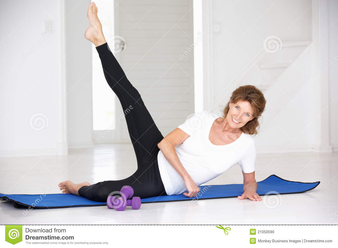 Senior woman working out in home gym stock photo image