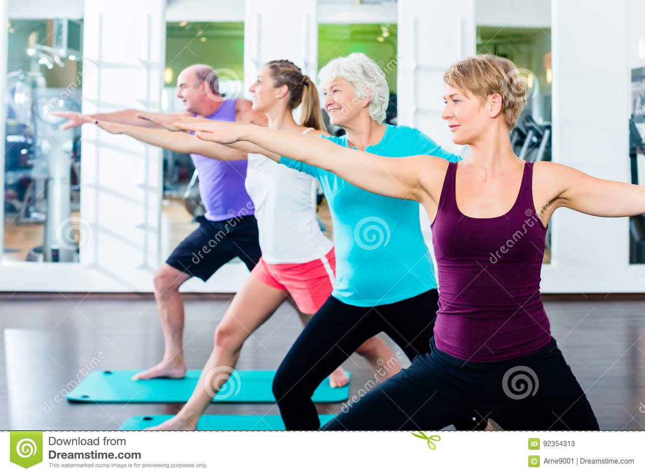 Senior and young people doing gymnastics in gym